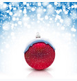christmas red ball with snow cap on snowfall vector image