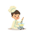 cute little boy chef with mixing bowl and a whisk vector image vector image