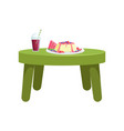 small green table with glass of juice and a fruit vector image