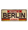 welcome to berlin vintage rusty metal sign vector image