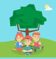 school kids reading books under a tree on nature vector image