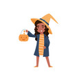 cute brunette little girl dressed as a witch with vector image vector image
