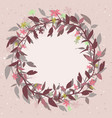pink background with a round floral frame in the vector image vector image