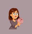 unhappy broke woman holding piggy bank vector image