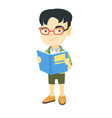 little asian schoolboy reading a book vector image vector image