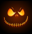 sinister pumpkin face on dark background vector image vector image