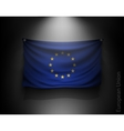 waving flag European Union on a dark wall vector image