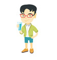 little asian boy holding a glass of water vector image
