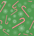candy cane on a green background merry christmas vector image