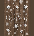 christmas text and snowflakes on wooden texture vector image vector image