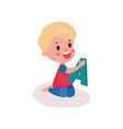 cute blonde little boy sitting on the floor vector image vector image