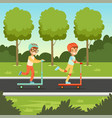 cute boy and girl riding kick scooters in the park vector image