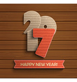 Happy new year 2017 design on wood background vector image vector image