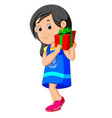 little girl holding a gift box vector image vector image