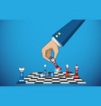 business hand holding chess piece to defeat rival vector image