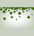 background with green three-leaved shamrocks vector image