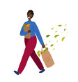 walking happy african man with purchases in hands vector image vector image