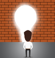 Businessman breaking trough a wall with idea vector image