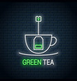 tea bag inside a tea cup neon sign green tea neon vector image vector image