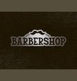 barbershop lettering on black background