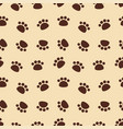 seamless pattern with brown animal footprints vector image vector image
