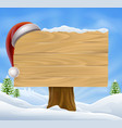 snow landscape christmas santa hat sign vector image