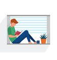 teenager reading a book in window vector image vector image