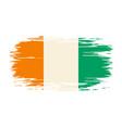 ivorian flag brush grunge background vector image vector image
