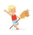 cute smiling little boy riding on wooden stick vector image vector image