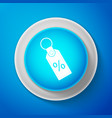 white discount percent tag icon on blue background vector image vector image