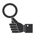 hand human with magnifying glass isolated icon vector image