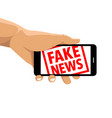 fake news rubber stamp cell phone vector image vector image