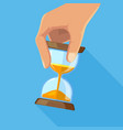 business concept picture of hourglasses in hand vector image