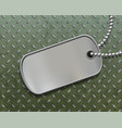military metal id tag on a steel background