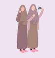 two girl take selfie together friends wearing veil vector image vector image