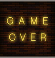 glass neon game over sign on solid red brick wall vector image vector image