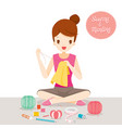 woman sewing and mending clothes by hand vector image