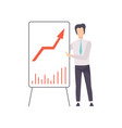 businessman in a suit pointing at a whiteboard vector image