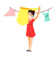 cheerful woman drying clothes vector image vector image