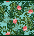 tropical leaves and flowers pattern vector image vector image