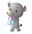 rhino holding baby bottle with nipple vector image vector image