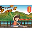 A girl exercising at the bridge with a lantern vector image vector image