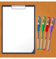 Tablet and pens on the table vector image vector image