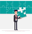 happy businessman or manager collects a puzzle vector image