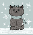 gray cat with blue scarf under falling snowflakes vector image