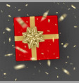 a realistic red gift box decorated with a gold bow vector image vector image