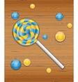 Colorful candy on wooden texture vector image vector image