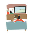 young man is watching tv with his dog on sofa vector image vector image