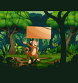 a monkey holding an empty wooden sign board in the vector image vector image