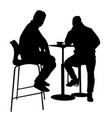 two mans silhouette sitting at a table in the vector image